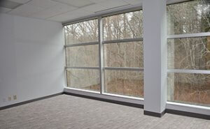Example of a key man office featuring floor to ceiling windows (outside offices only)