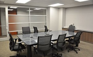 Located on the second floor, this conference room provides a comfortable meeting area for medium sized groups